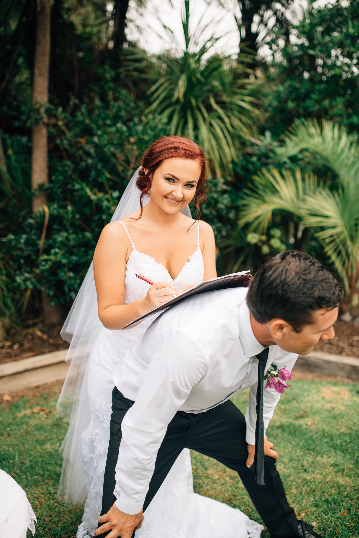 Bride signing registry- Garden wedding
